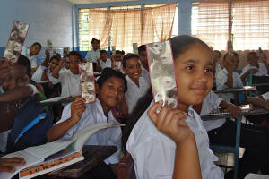 Panamanian school children are given bookmarks
